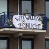 Spandoeken tegen nieuwbouw hoge flat Spoorstraat. Nijmegen, 16-9-2013 . dgfoto.