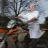 cwz-orthopeed gerrit jan van norel Van Norel is onderscheiden met de sporthart-wisselbeker van het nationale motorsportgala omdat hij veel kampioenen in de motorsport helpt met verbanden en goede adviezen bij blessures; hij klimpt in zijn witte doktersjas en met wisselbeker op zijn Ducati, 1100 cc. . Overaselt, 30-1-2014 . dgfoto.