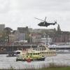 oefening speciale troepen , bevrijding vip op de Waal met helicopter, speedboten. vip zit op Pannenkoekenboot. Nijmegen, 18-4-2014 . dgfoto.
