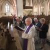 kruiswegstatie in kerk Lent (Maria Geboortekerk). Priester Frank Bomans gaat voorop, . Nijmegen, 14-4-2017 .
