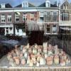 """""""kunstenares monique van stookem exposeert stad uit de rivier (stad uit stenen) in etalage , boekhandel Stap voor Stap"""""""
